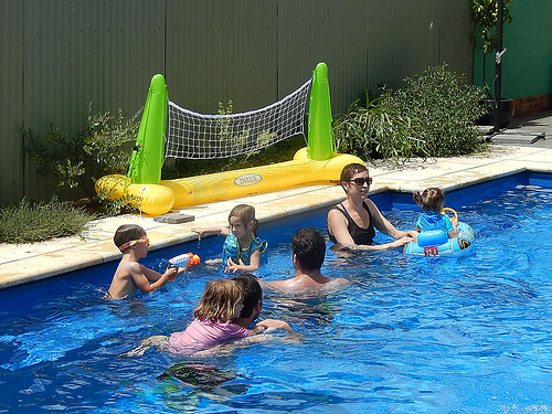 family swimming in a pool