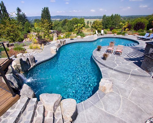 Installing a pool 7 hot design trends mypoolsigns blog for Pool design trends